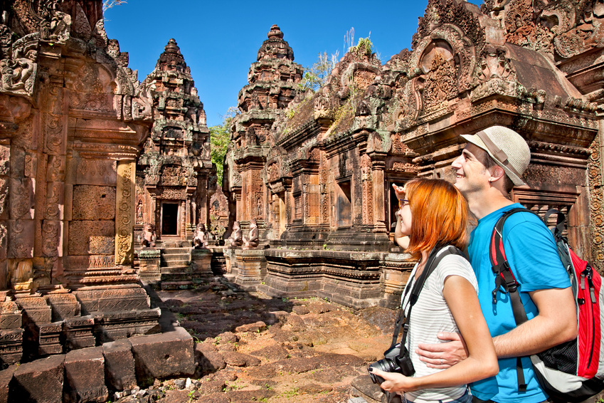 Beautiful young couple at Banteay Srei temple, Cambodia.
